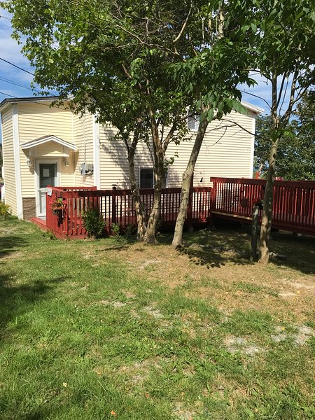 Front entrance. Ample parking for more than one car directly adjacent to the house. Extensive patio