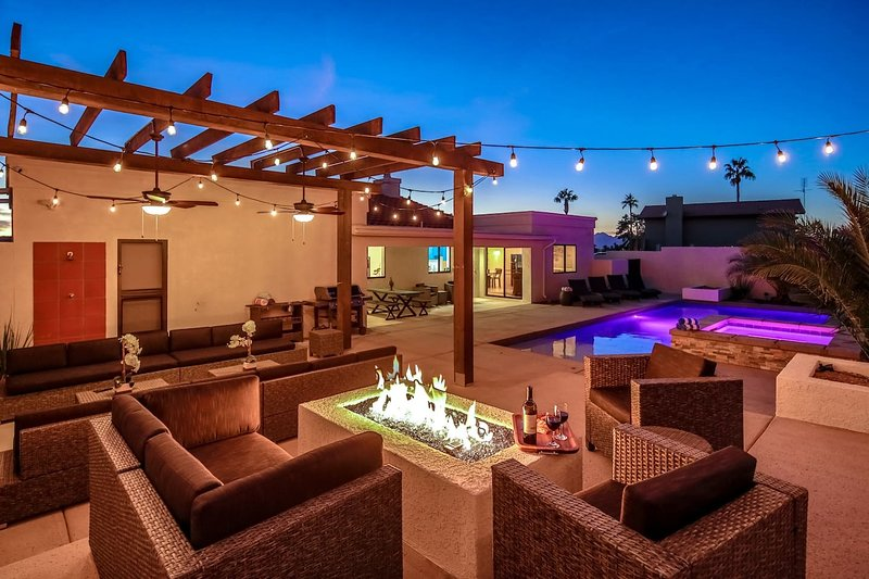 Outdoor living with custom fire pit, pool, and spa!