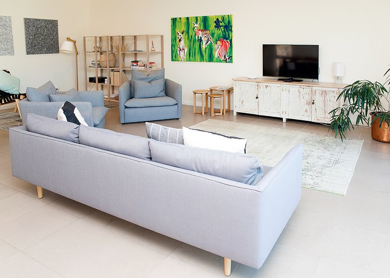 Living area with Smart TV, blu tooth sound system, DVD's