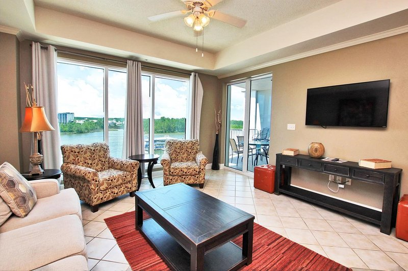 Waterfront Living Room with Balcony Access