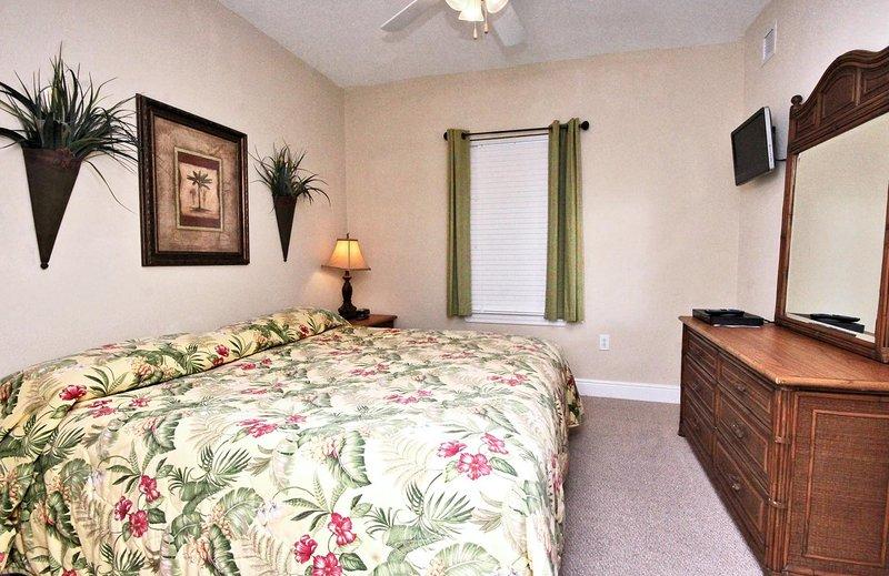 Chambre d'hôtes avec un écran plat et un lit king size
