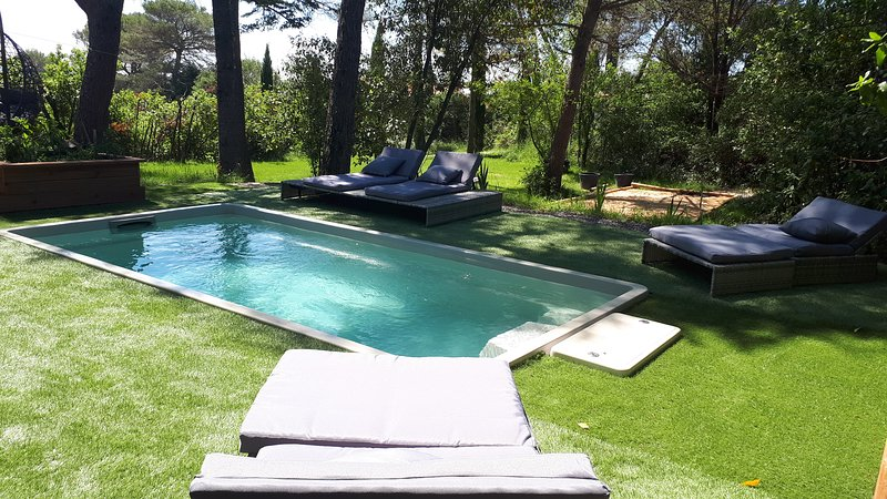 Heated pool, swimming against the current, seating massage.