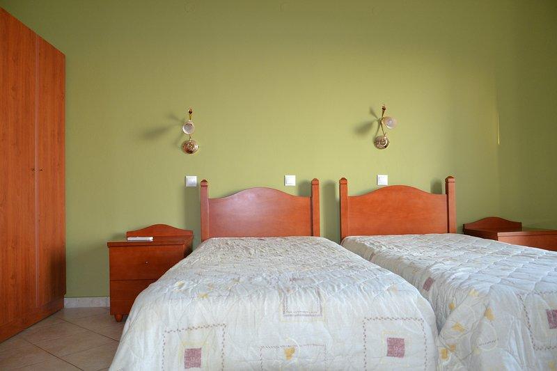 Kefalonia hotels. Lourdas apartments: Eagle's Nest studios -each room offers 2 single beds.