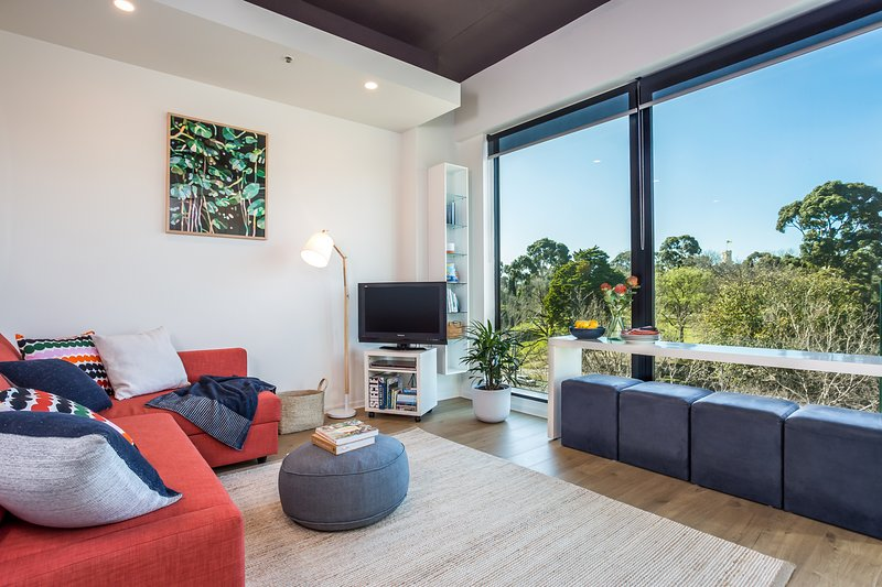 The lounge room is spacious and comfortable.  Enjoy the view while you relax on the couch.