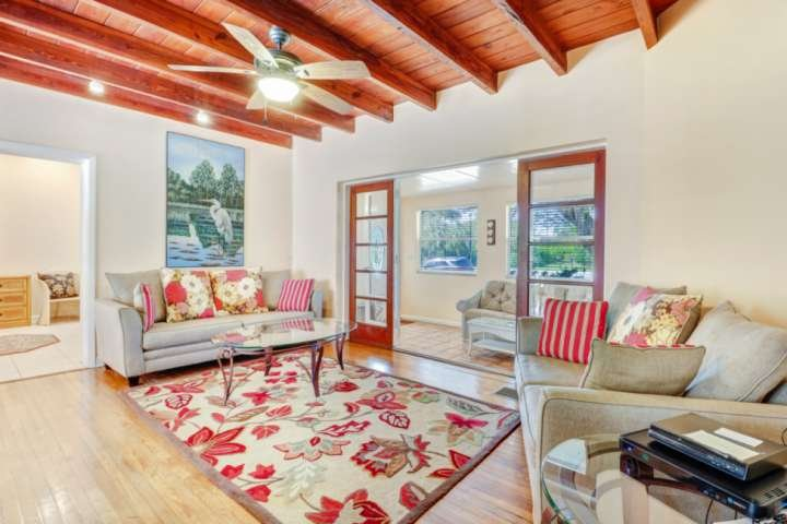 Say hello to this charming beach house with unexpected details like hardwood floors, exposed beam ceilings, and thoughtful upgrades throughout.