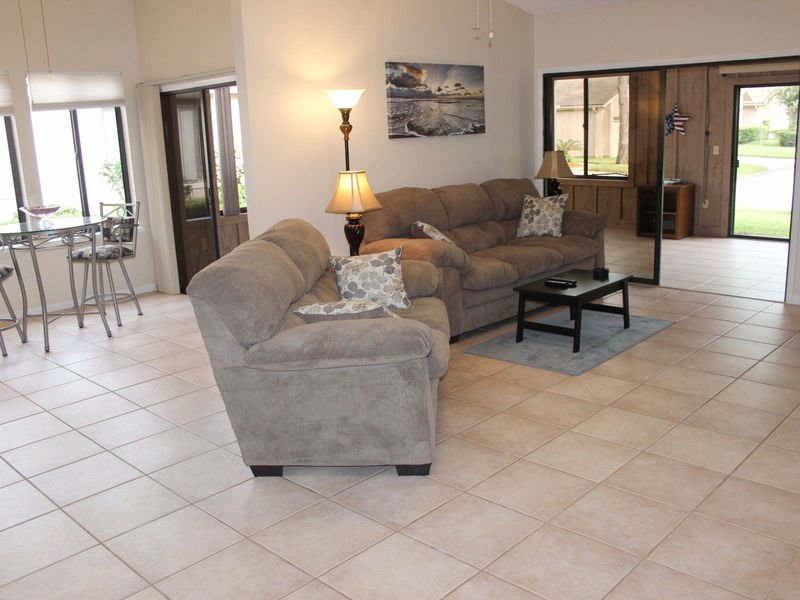 Spacious living area with breakfast nook.