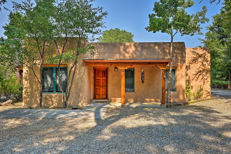 This 3-bedroom, 2-bathroom southwestern paradise in Taos awaits you!