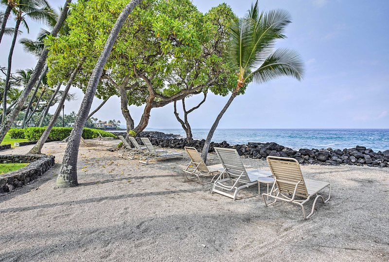 Soak in the sun in one of the chaise lounge chairs beside the ocean.