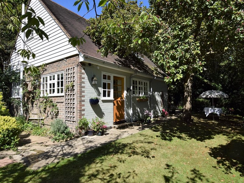 Relax in the secluded garden at this delightful cottage