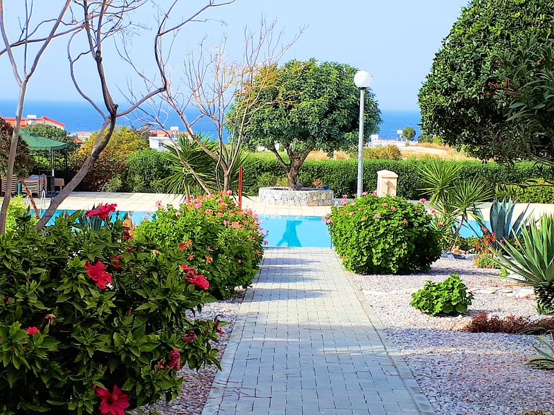 Lovely walk through our sumptuous gardens to our big communal pool with plenty of free sunbeds