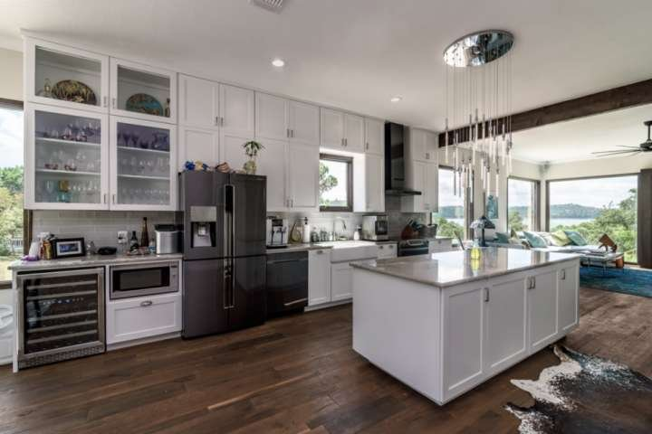 Gourmet kitchen with stainless steel appliances and a view that just doesn't end