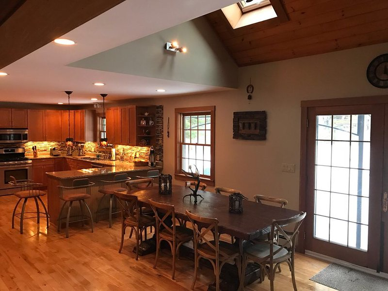 Dining Room with Reclaimed Wood Table for 8+ and Kitchen with Top of the Line Appliances