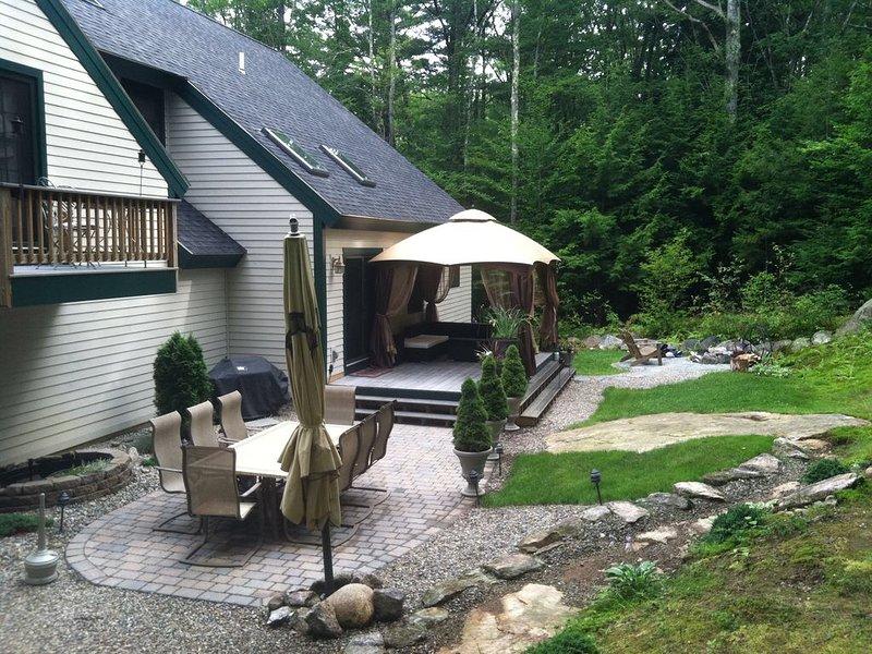 Back Yard with a Patio, Seasonal Gazebo and Granite Fire Pit