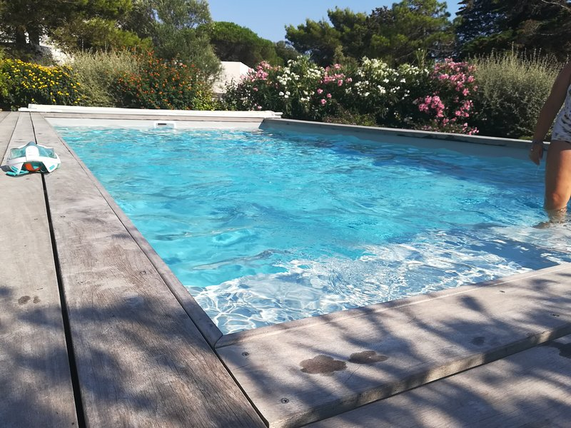Pool 4.5 by 9m with large steps and Roman bath
