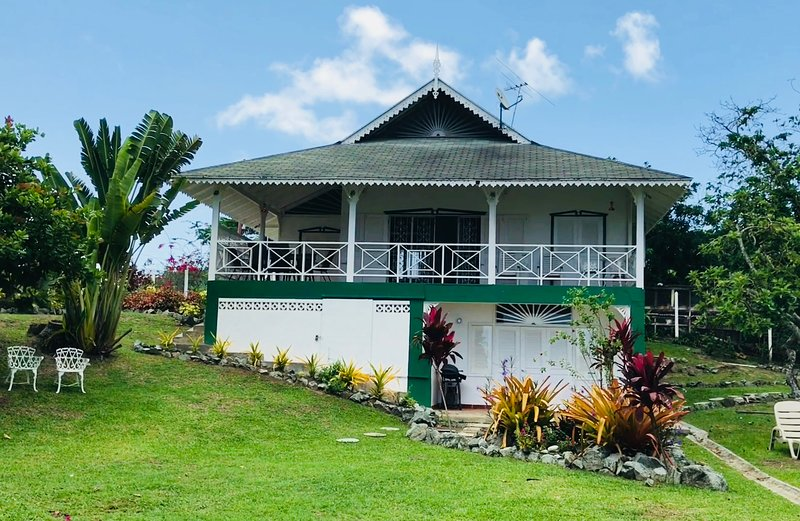 Sandy Bay Cottage, just steps away from the shallow bay and Caribbean Sea