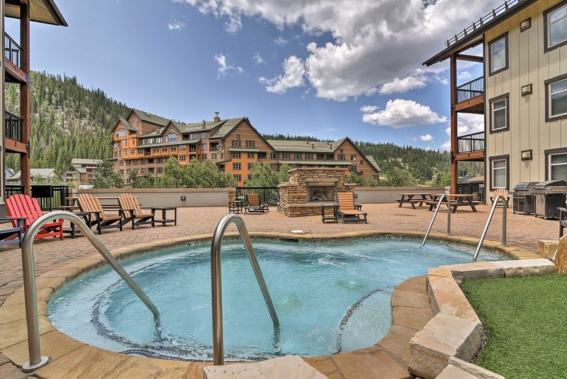 Unwind in the in the community hot tub after a long day of skiing at the resort.