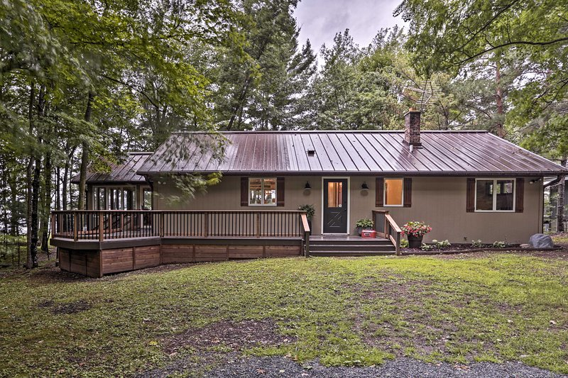 Escape to Luck and stay in this waterfront vacation rental cabin on Bone Lake!
