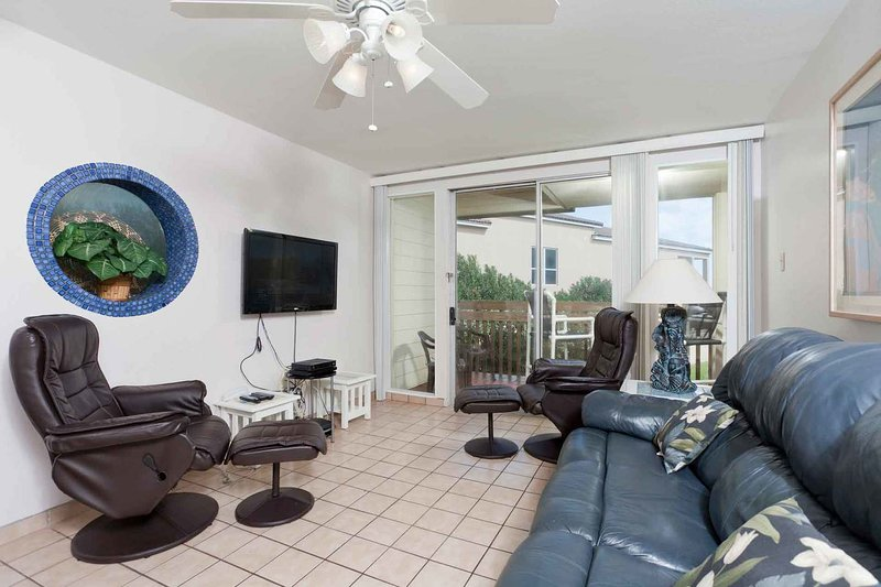 The living area has a TV an direct access to the balcony.