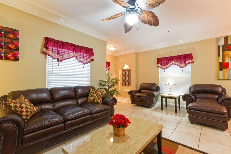 Our living area with deep leather seats will make you feel like you're nestled in a study. You'll love catching up on your reading list here.