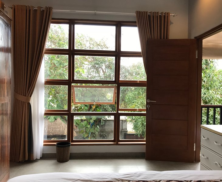 Large window of the master bed room, facing the front garden.