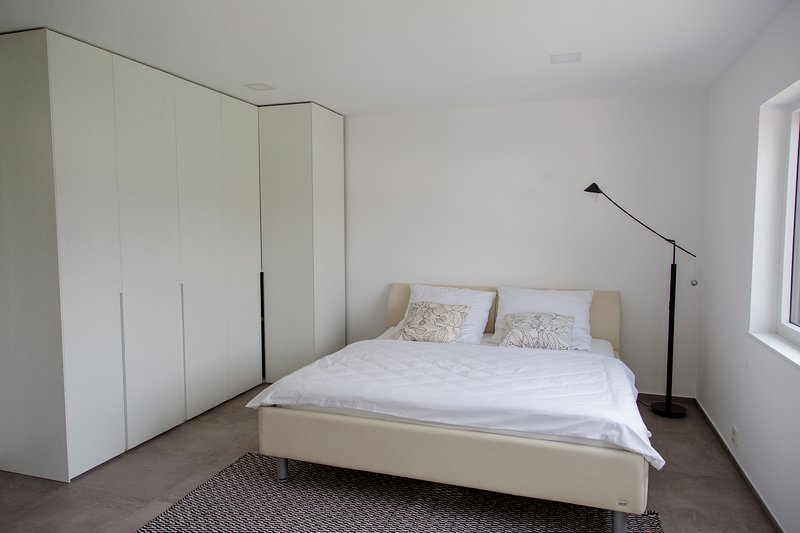 Large bedroom with double bed and wardrobe