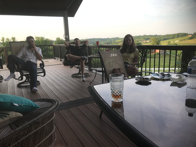The deck has many chairs and a table for 6.