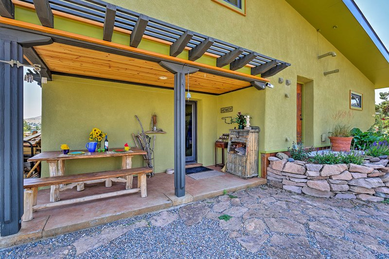 New stucco decor and a charming color scheme tie together this property.