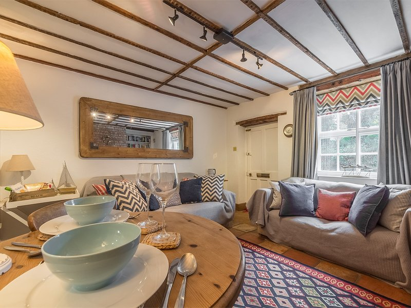 Wooden beams and comfy sofas
