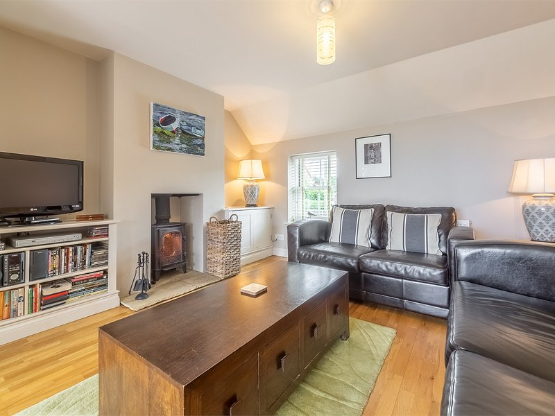 Relax in front of the warming wood burning stove