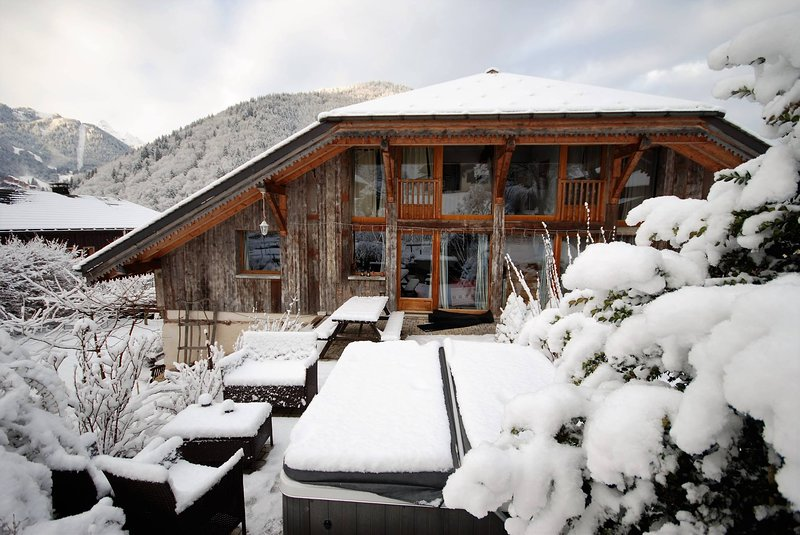 Front of the chalet and hot tub