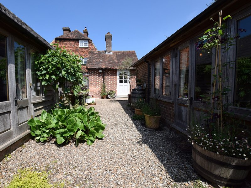View towards the cottage and the summer house with en-suite shower room