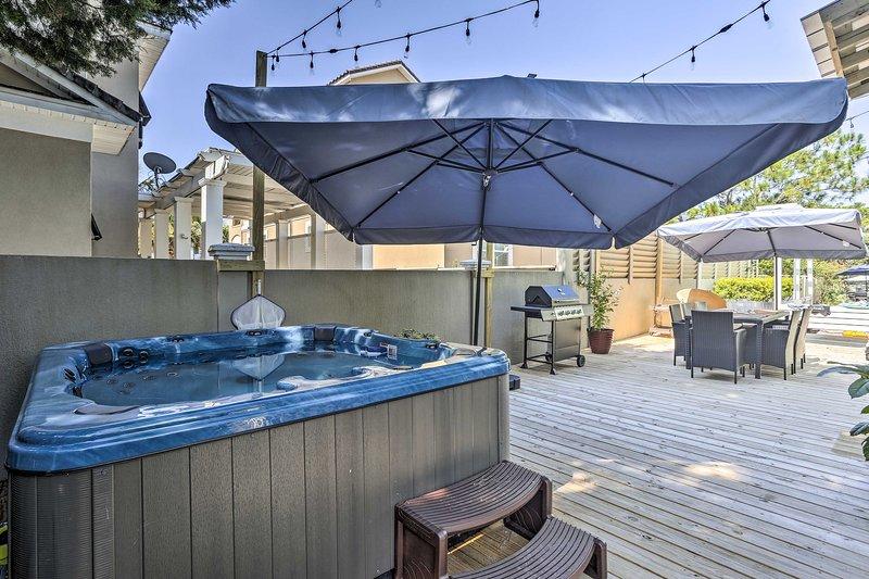 Trempez-vous dans le bain à remous de cette maison de vacances après une journée à la plage.