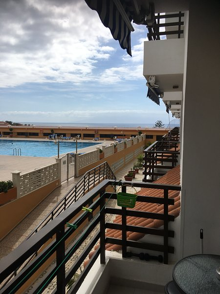 view of the sea and swimming pool