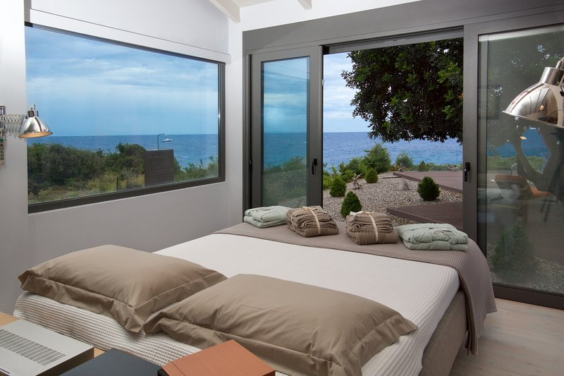 Sea view from the ergonomic bed that can be adjusted for your comfort using the wireless remote.