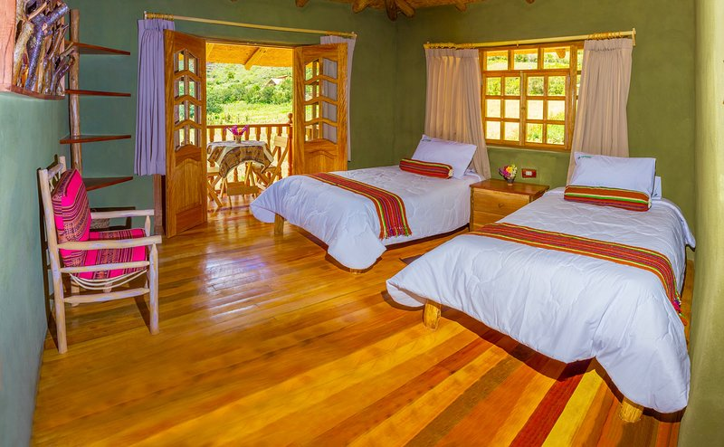 Chinchero Twin Deluxe Room. The room has 2 beds, spacious private balcony and bathroom with bathtub.
