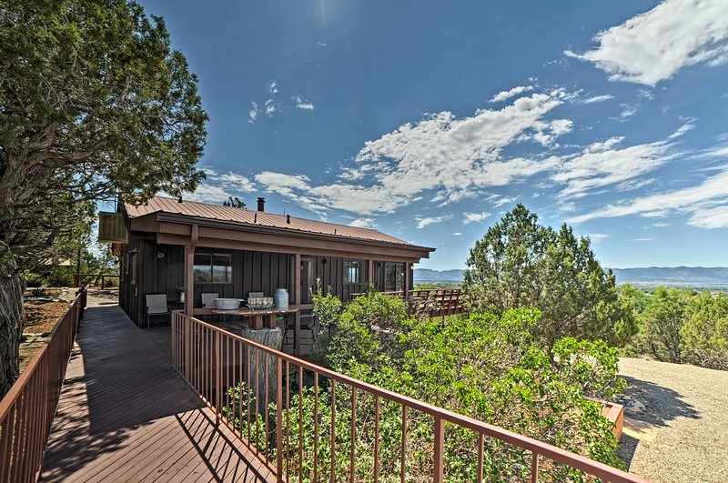 This home reveals dramatic panoramic views of the San Juan Mountains!