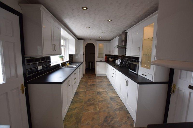 Fully equipped kitchen with utility area, dishwasher, washing machine and fridge freezer