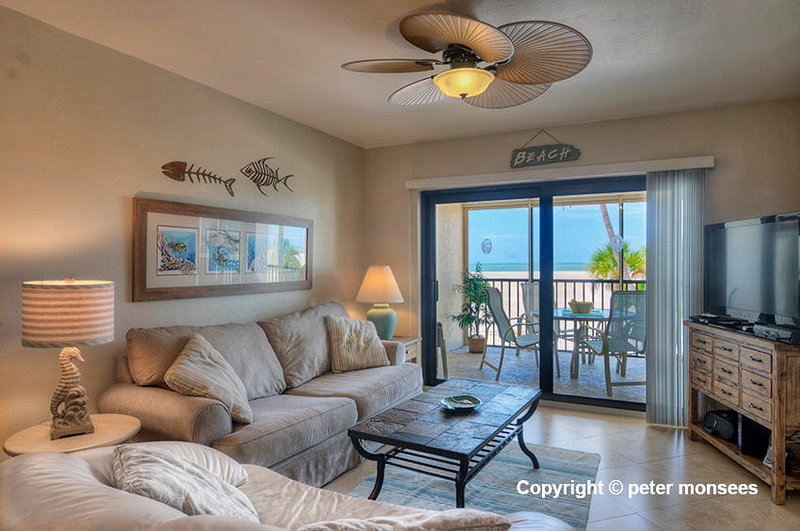 Gorgeous Remodeled First Floor Beachfront Condo at Carlos Pointe, vacation rental in Survey Creek