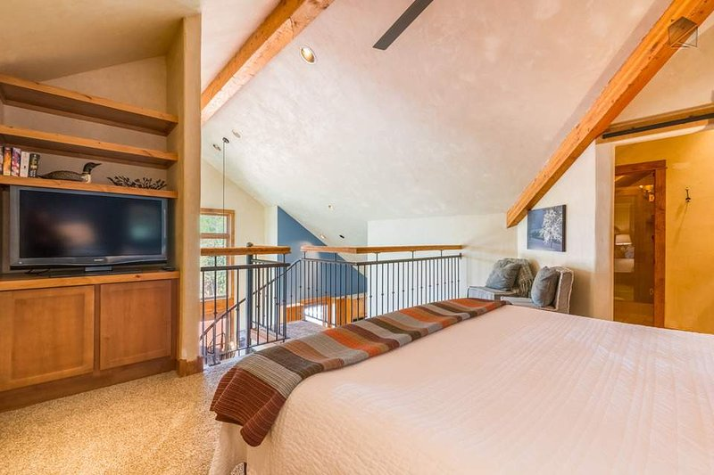 The loft bedroom is fairly private, though it is open to the downstairs living area below.