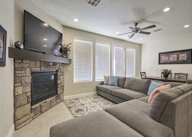 Living room with fireplace/TV and seating for 6/patio access
