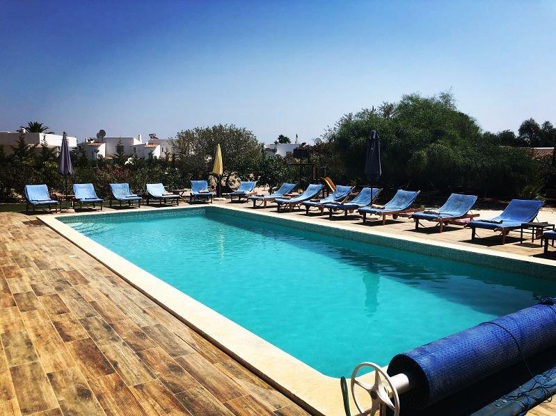 Villa Mediterraneo a stunning villa, large pool, man-made beach, fun for all!!!, holiday rental in Carvoeiro