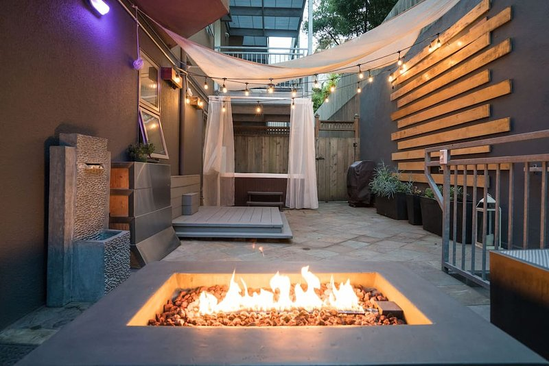 Private Patio - equipped with a hot tub, fire pit and lounge.