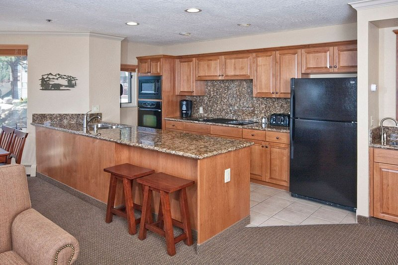 Cook up a storm in the fully-equipped kitchen with modern appliances.