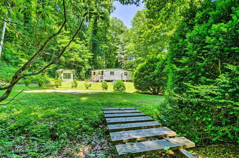Esta casa está enclavada en el exuberante bosque, ¡para una relajación óptima!