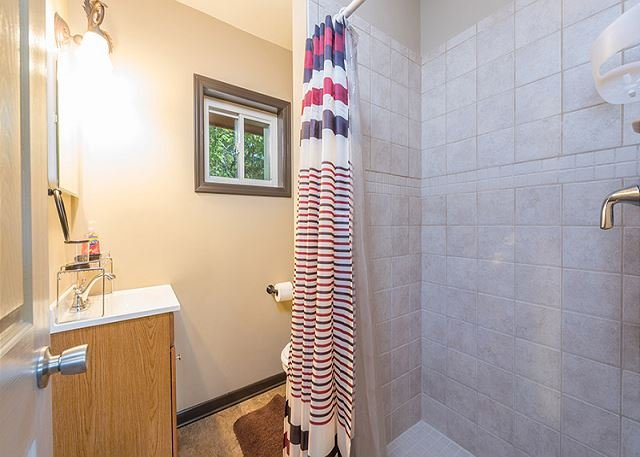 Full bathroom with walk-in shower only.