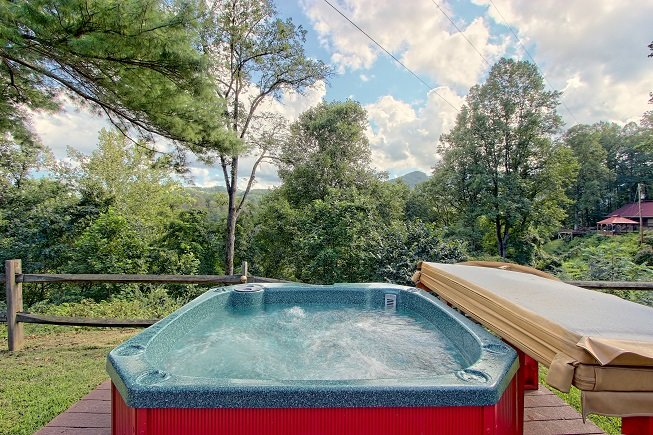 One of two hot tubs on property. Hot tubs are open to all guests at Sunset Farm Cabins.