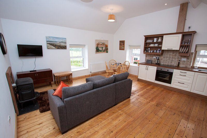 The kitchen/living room is upstairs, well kitted out with simply fabulous views direct from the sofa