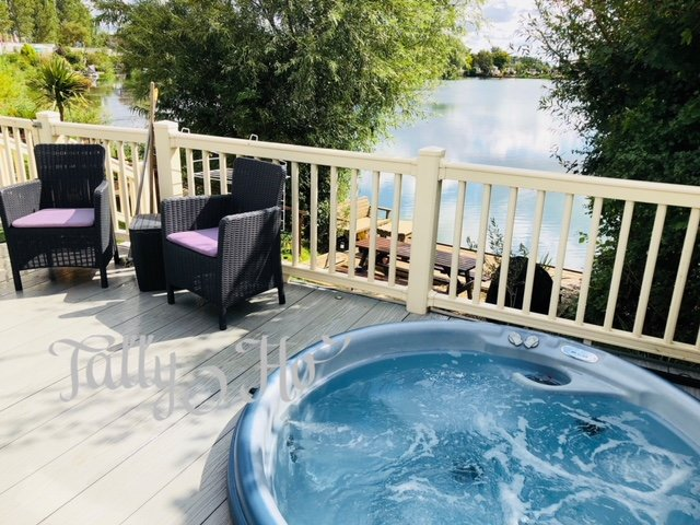 Large south facing decked area with private fishing and tub !