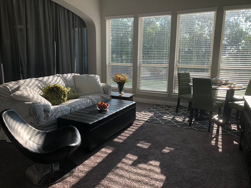The living area has a beautiful view, large windows, light and sunny.