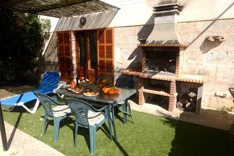 Rear terrace of the farm with barbecue for dinner